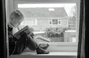 Child And Book by George Hodan